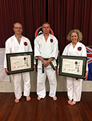 Mark and Deanne receiving their Shodan Menjo at the Zealand Shibu image