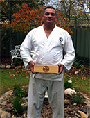 Dwayne Sempai from Queensland, holding the box containing the Takahashi Obi image